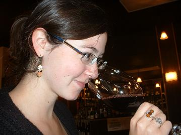 Mel sniffing wine